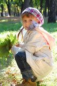 Autumn fashion leaves child — Stock Photo