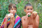 Kids having dinner outdoor — Stock Photo