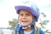 Happy girl wearing a helmet — Stock Photo
