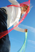 Child ribbons and sky — Stock Photo