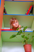 Child in the bookcase — Stock Photo