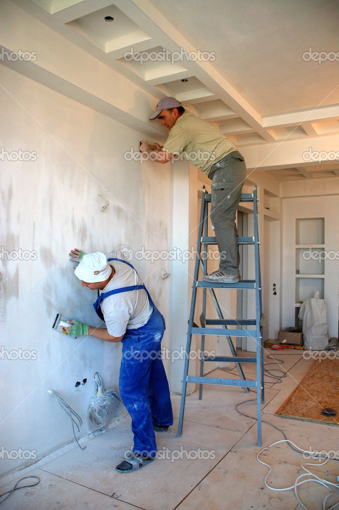 Two construction workers working making indoor plastering jobs — Foto Stock #1006877