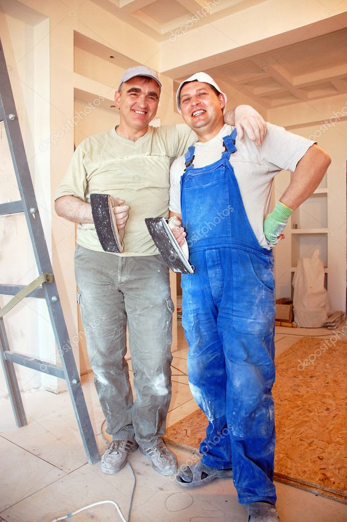 Two happy smiling man workers at construction  Stock Photo #1006880