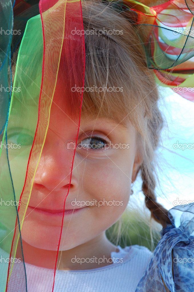 Portrait of a little girl with ribbons on her head — Stock Photo #1006993
