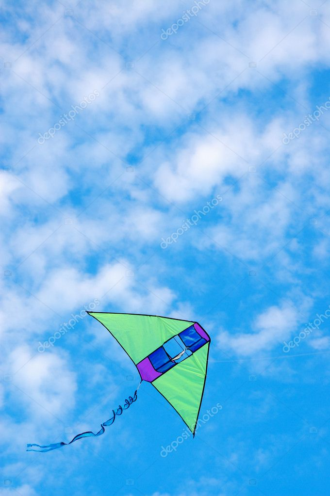 Toy kite flying the blue cloudy sky — Stock Photo #1007414