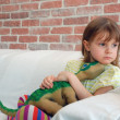 Royalty-Free Stock Photo: Child with a toy dinosaur
