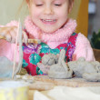 Child playing with clay — Stock Photo #1012275