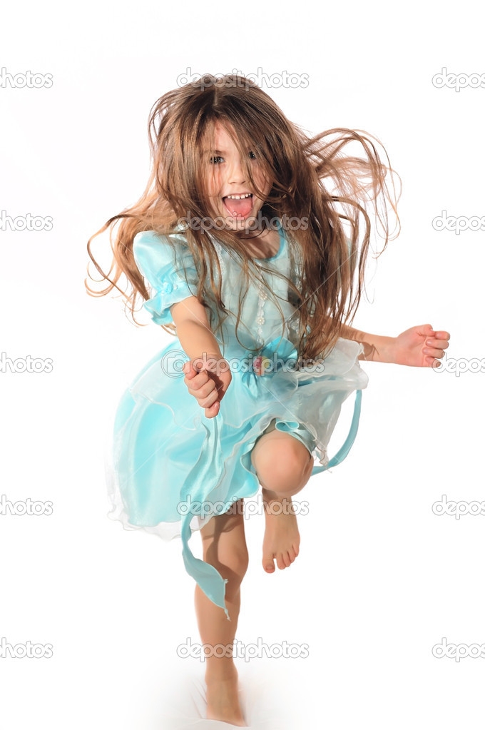 Happy laughing little long hair girl dancing   Stock Photo #1011170