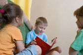 Reading kids at home — Stock Photo