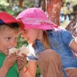 Children eating icecream — Stock Photo
