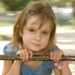 Stock Photo: Swingn around little girl