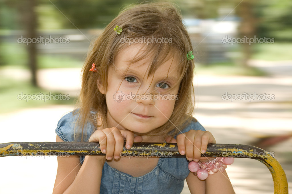 Portrait of a 5 year old girl swinging around  Stock Photo #1215031