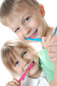 Children cleaning teeth — Stock Photo