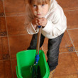 Tired child cleaning up — Stock Photo #1239142