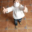 Child with pretective mask and thumbs up — Stock Photo #1256944