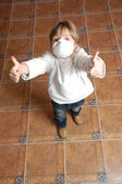 Child with pretective mask and thumbs up — Stock Photo