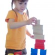 Kid playing with bricks — Stock Photo #1265991