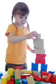Kid playing with bricks — Stock Photo