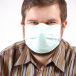 Man wearing a surgical mask — Stock Photo