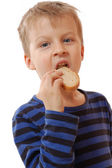 Lid eating bread — Stock Photo