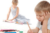 Thoughtful children drawing and reading — Stockfoto