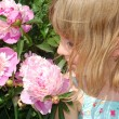Girl with peonies — Stock Photo