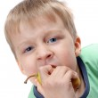 Boy biting a paer — Stock Photo #1369953