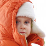 Child wearing winter clothing — Stock Photo