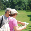 Senior couple tourists with map — Stock Photo