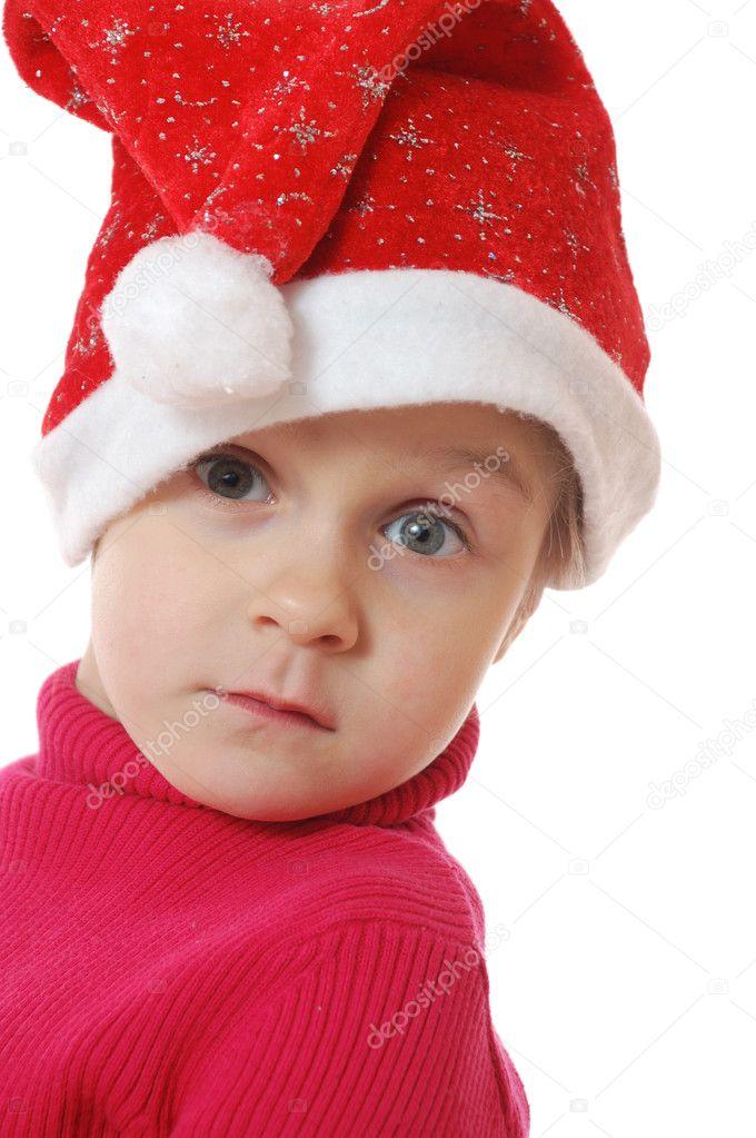可爱的小女孩戴着圣诞老人子句帽子