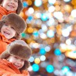 Winter kids with colorful lights — Stock Photo