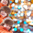 Stock Photo: Winter kids with colorful lights