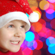 Cute little smiling Christmas hat child - Stock Photo