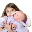 Girl with a doll — Stock Photo