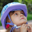Child with helmet - Stock Photo
