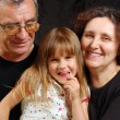 Grandparents with their granddaughter — Stock Photo