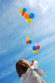 Child with balloons — Stock Photo