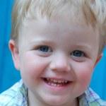Smiling little blond toddler boy — Stock Photo