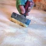 Worker brushing — Stock Photo