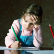 Stock Photo: Child doing school homework
