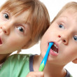 Stock Photo: Brushing teeth children