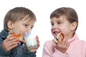 Children having lunch with milk — Stock Photo