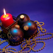 Foto Stock: Christmas background with candle and dec