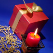 Holiday background on blue with burning — Stock Photo