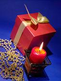 Holiday background on blue with burning — Stock Photo