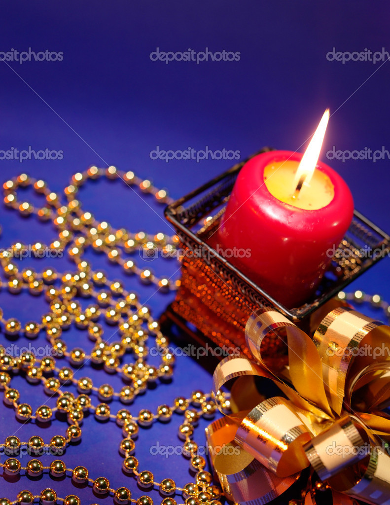 Christmas background with candle and decorations on blue — Stock Photo #1008816