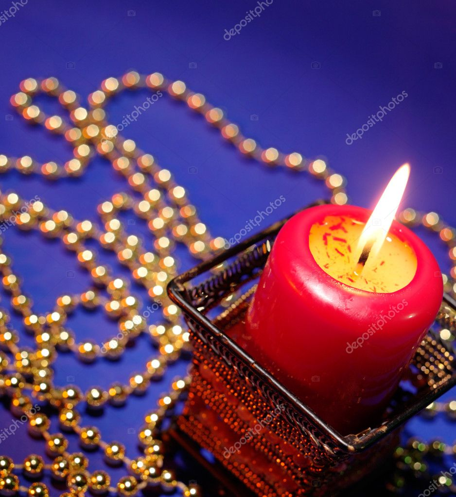 Holiday background on blue with burning candle  Stock Photo #1008912