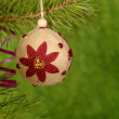 Foto Stock: Xmas handmaded ball on the green backgro