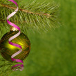 Royalty-Free Stock Photo: Xmas green ball on the green background.