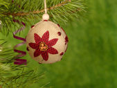 Xmas handmaded ball on the green backgro — Stok fotoğraf
